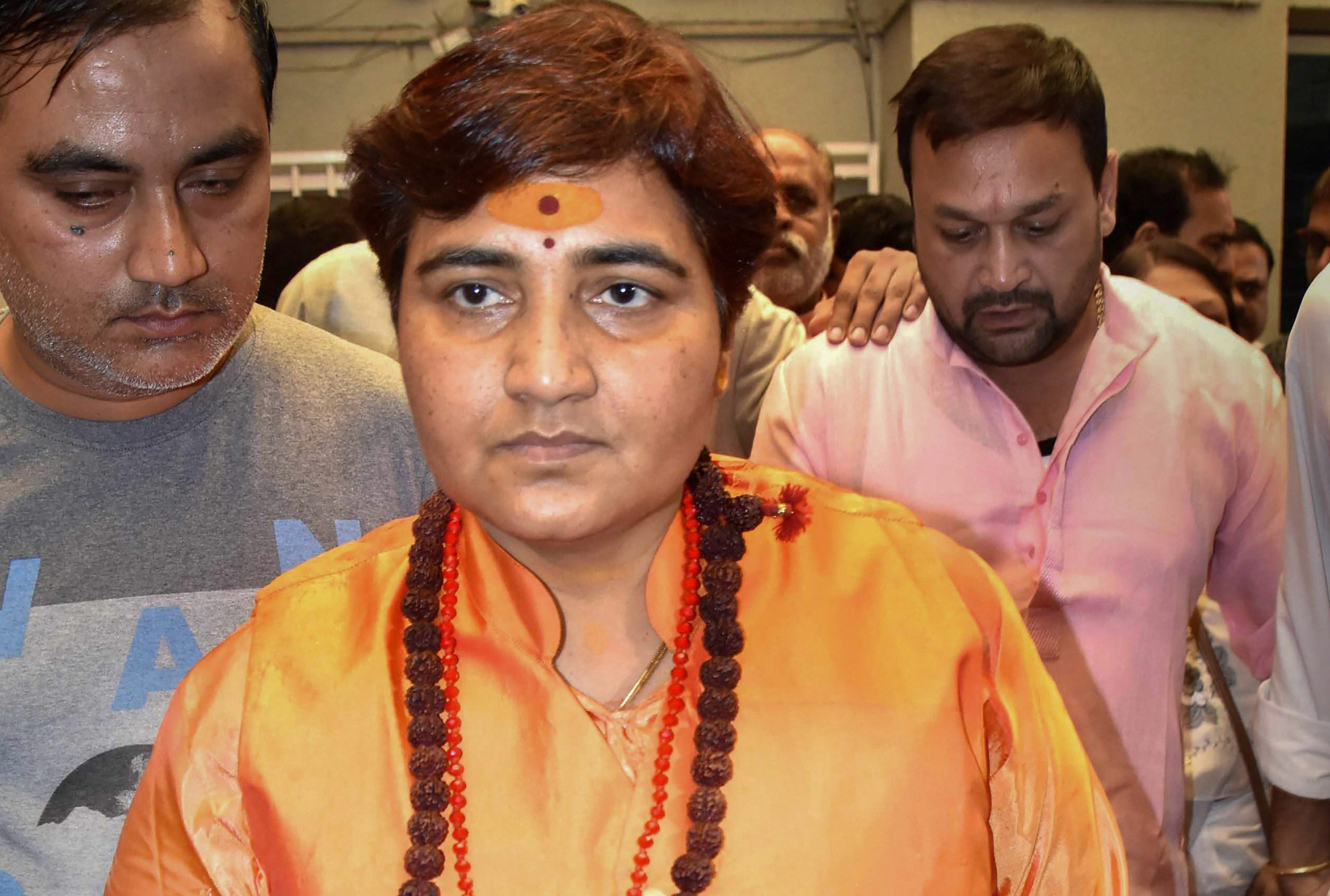 Pragya Singh Thakur arrives at the Madhya Pradesh BJP headquarters in Bhopal on Wednesday, April 17. That the BJP inducted her just before announcing her candidacy indicates its wish to employ a full-on Hindutva strategy with its unmistakable undertone of threat and violence