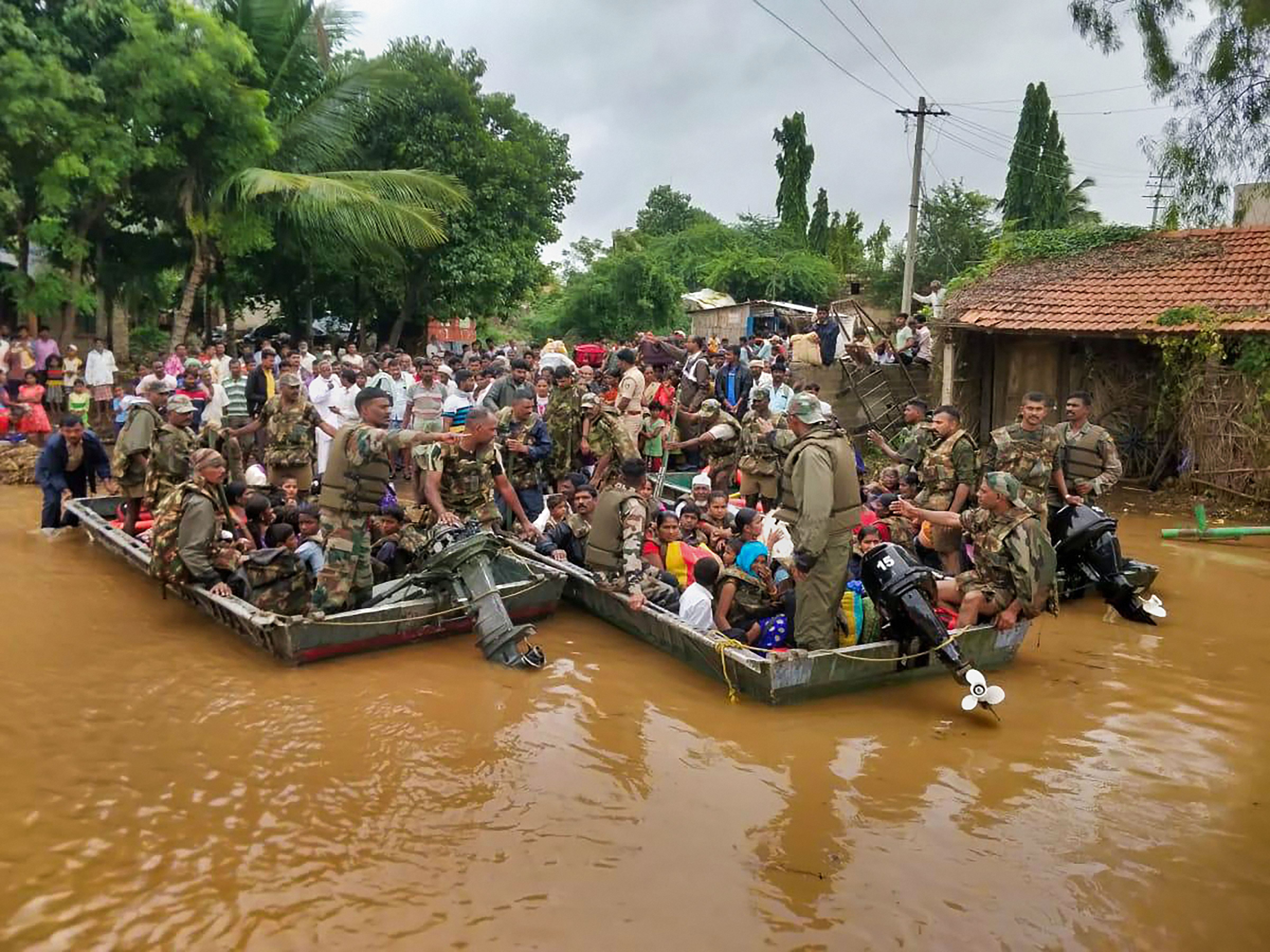 Army personnel on a rescue operation in Belgaum, Karnataka, on August 9.