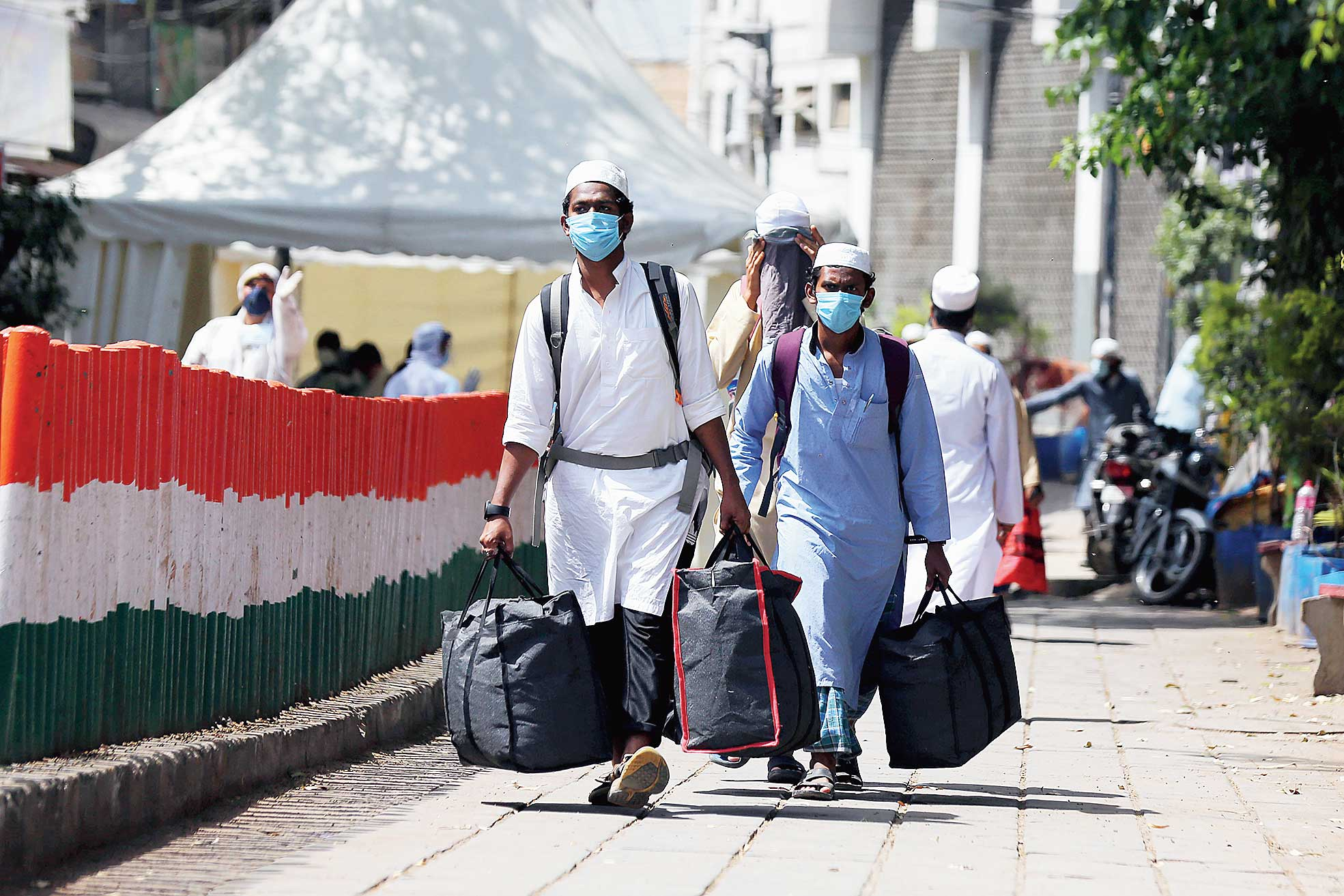 People who came for a religious gathering at Nizamuddin Mosque in New Delhi being taken to the LNJP hospital for Covid-19 test after several of them showed symptoms of the coronavirus on Tuesday.