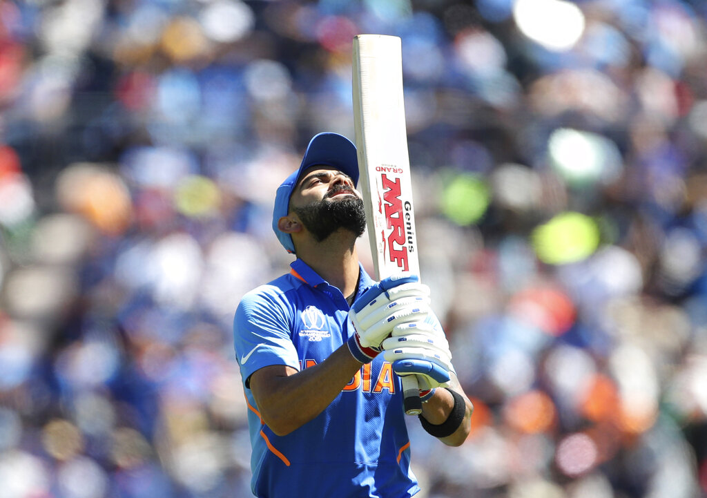 Virat Kohli reacts as he leaves the field after being dismissed by Afghanistan's Mohammad Nabi during the Cricket World Cup match between India and Afghanistan in Southampton, England, on Saturday, June 22, 2019.