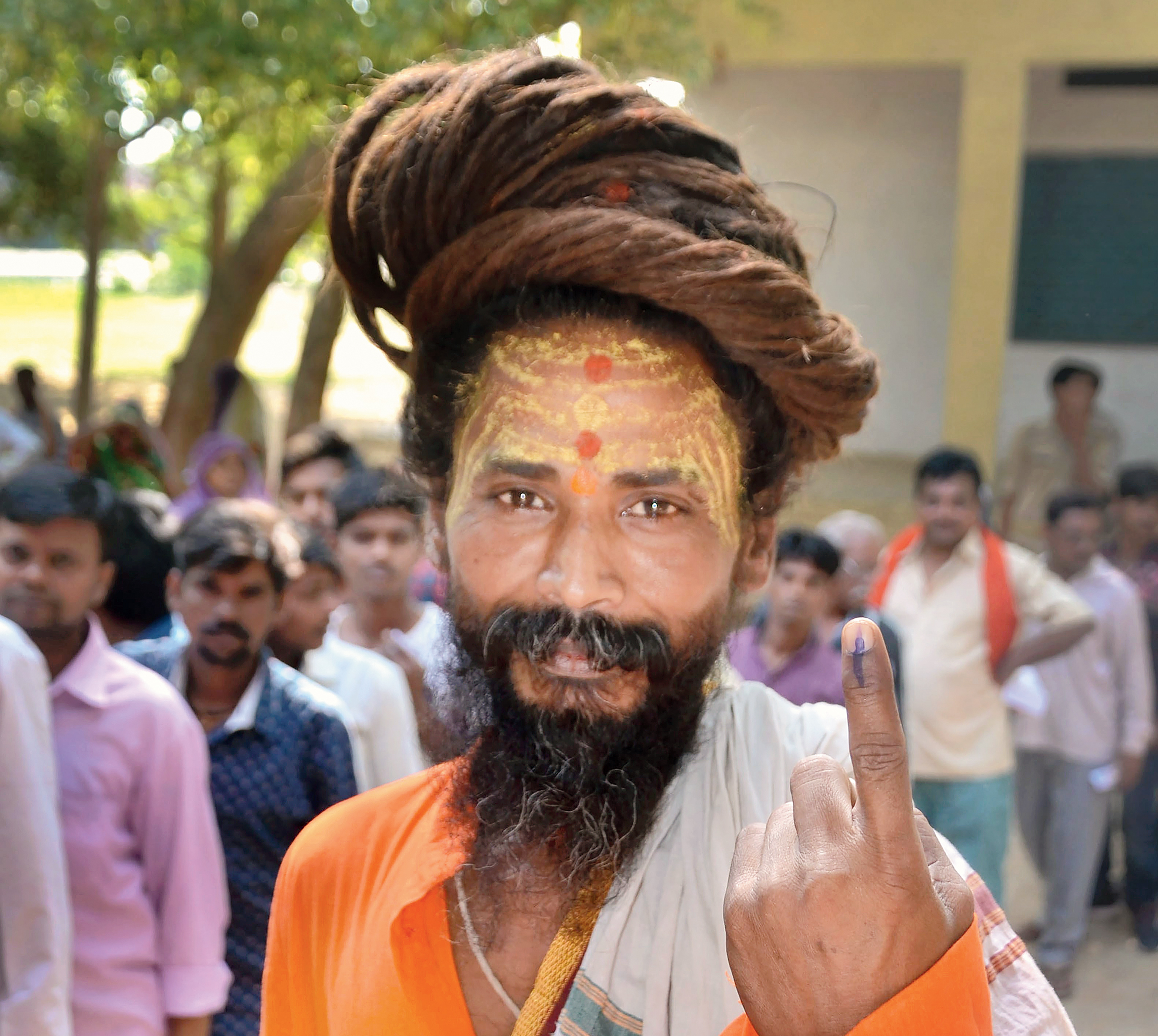 A voter shows his inked finger at a polling station in Mirzapur on Sunday.