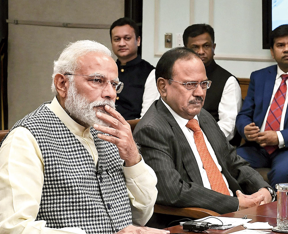 Narendra Modi and national security adviser Ajit Doval at an event in New Delhi on Monday. Congress leader Rahul Gandhi pointed out on Monday that Doval had escorted Masood Azhar in 1999 to Kandahar where the terrorist was freed.