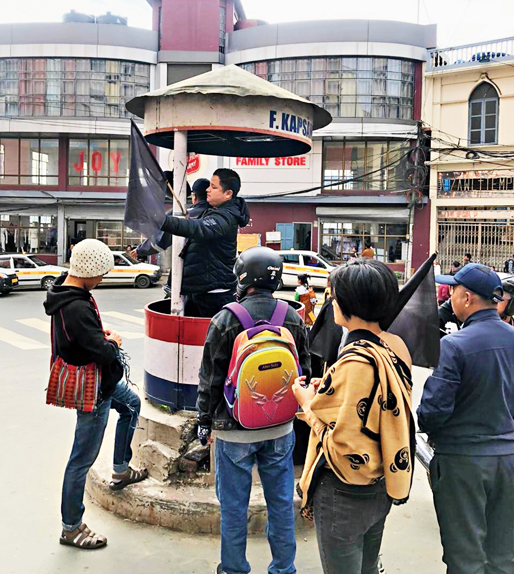 MZP activists put up black flags at a traffic circle in Aizawl on Thursday.