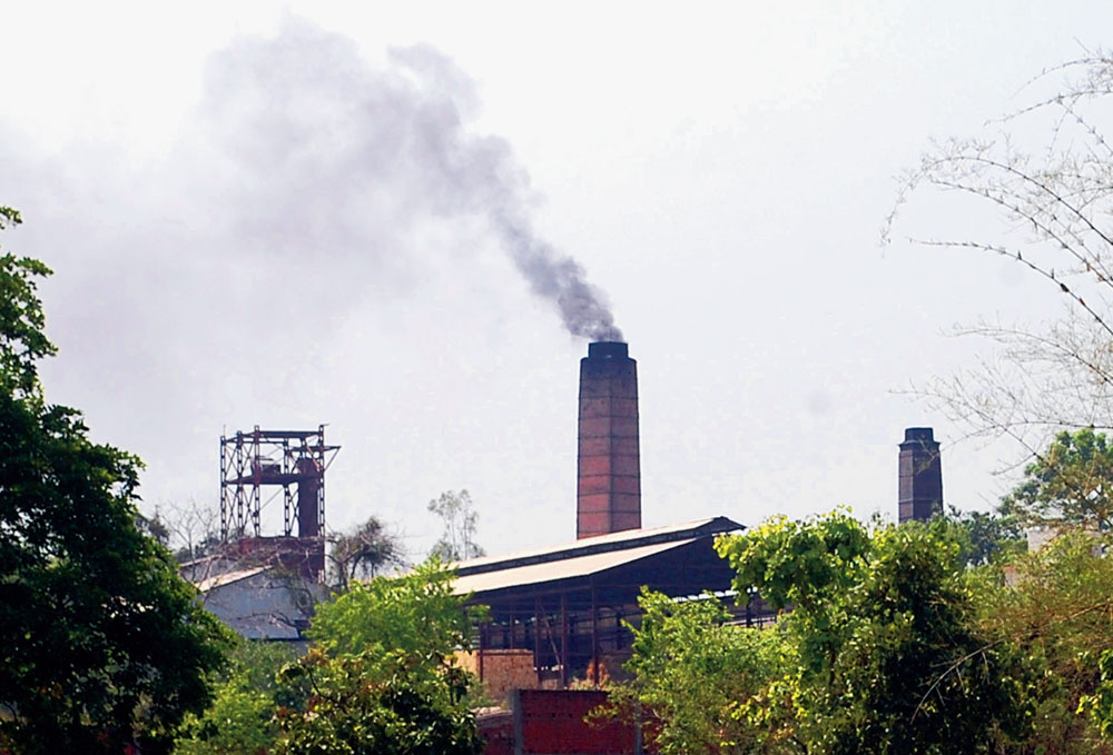 Smoke comes out of a chimney of a hard-coke factory on GT Road in Dhanbad on Friday.