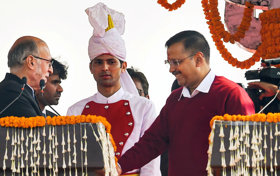 Delhi lieutenant-governor Anil Baijal (left) greets AAP convener Arvind Kejriwal after he took oath as the chief minister of Delhi for the third consecutive time, at a ceremony in the Ramlila Maidan in New Delhi, on Sunday, February 16, 2020.