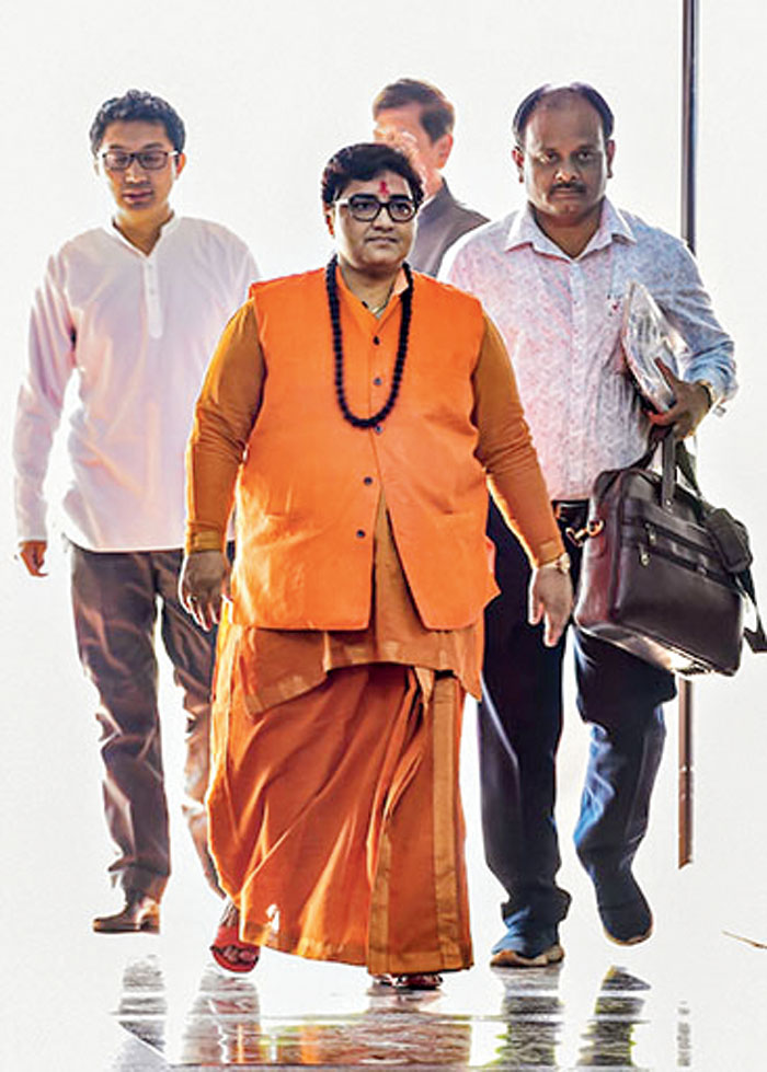 Pragya Singh Thakur (centre). Mere reproach from the BJP is not enough. She should be formally expelled from the party for her outrageous comments