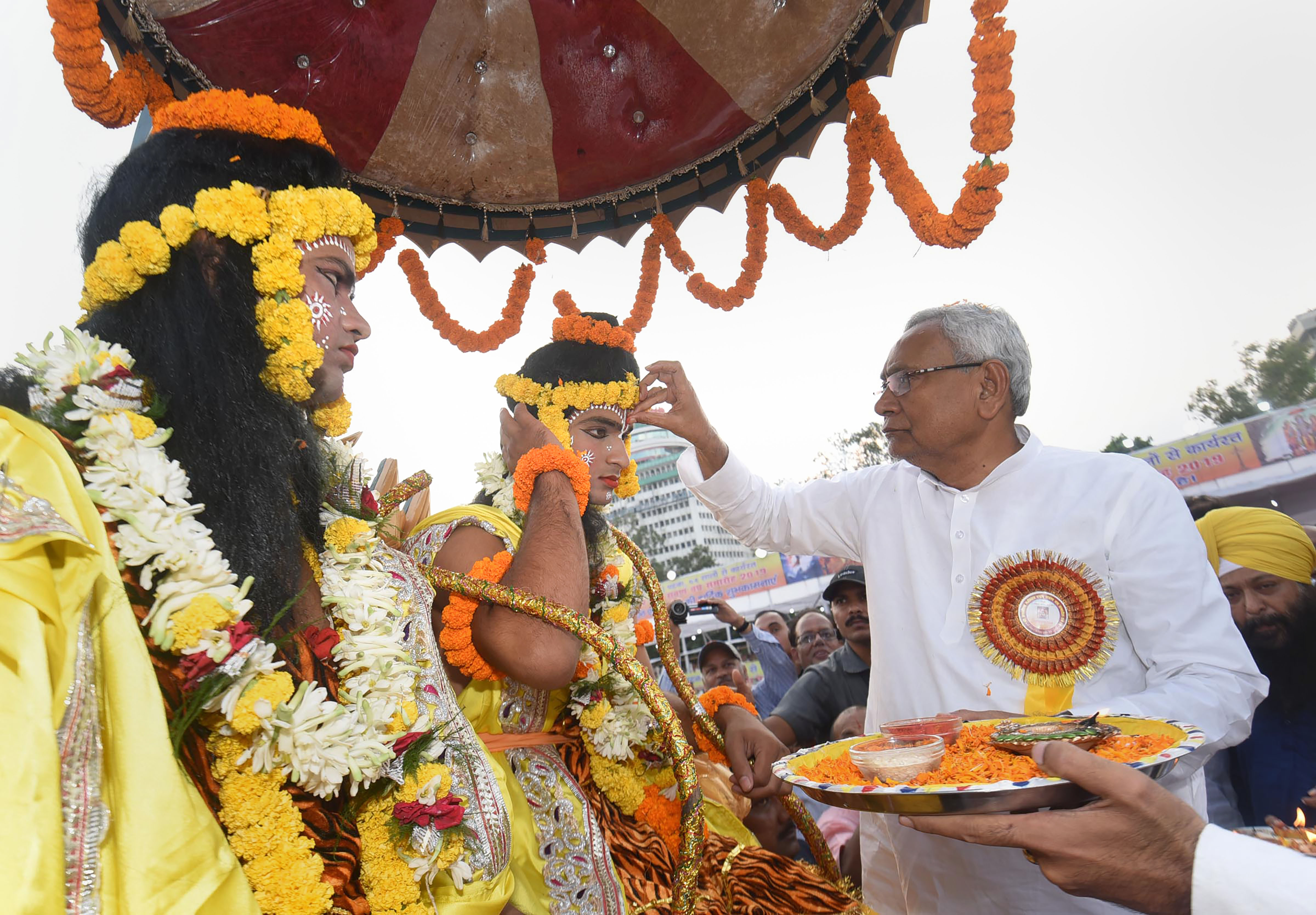 Bihar chief minister Nitish Kumar applies tilak on the forehead of an artist dressed as Lord Ram during Dussehra celebrations at Gandhi Maidan in Patna, Tuesday, October 8, 2019.