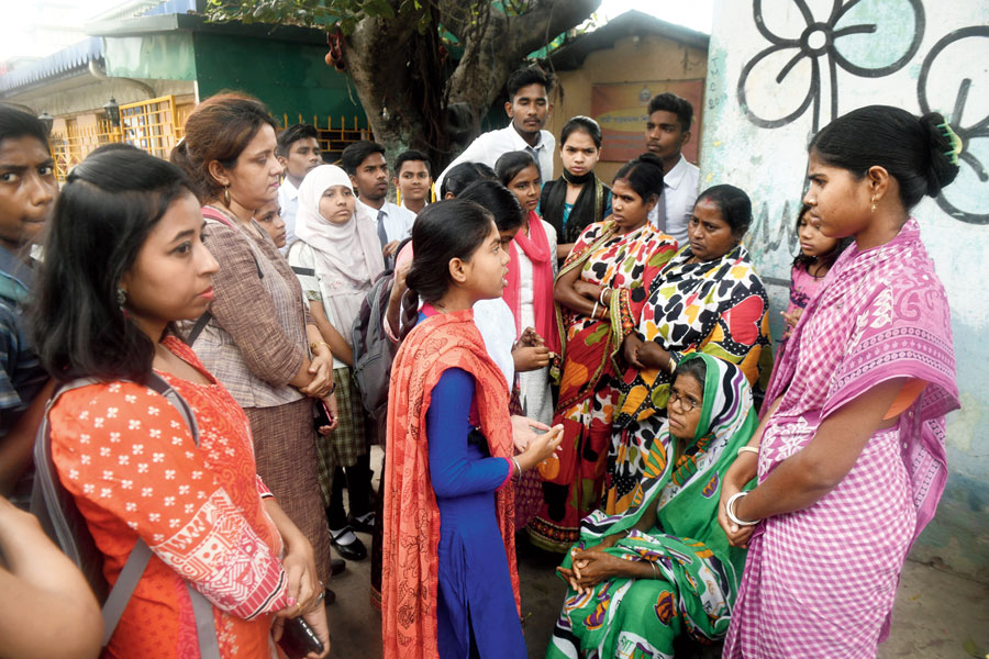 Students from Calcutta Rescue interact with mothers in a Bagbazar neighbourhood on Friday.