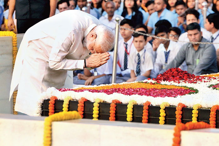 Narendra Modi pays his respects to Mahatma Gandhi on the 150th birth anniversary of the Father of the Nation on October 2