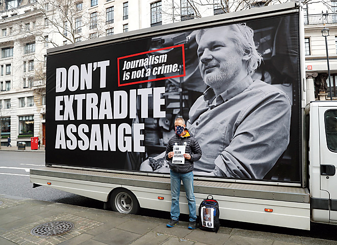 A pro-Assange demonstrator stands outside the Australian High Commission as they gather to protest against the extradition of Julian Assange, in London, Britain February 22, 2020.
