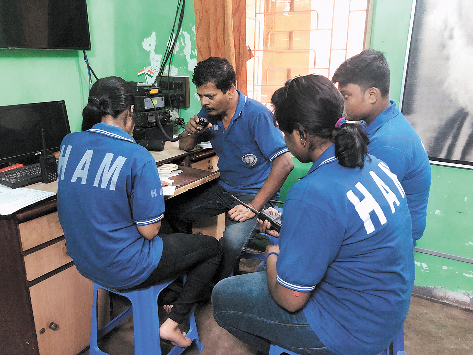 Only connect: Ambarish Nag Biswas with his team at his residence-cum-control room in Sodepur