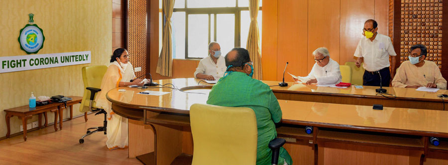 Bengal Chief Minister Mamata Banerjee holds a meeting with Left Front Chairman Biman Bose, CPI(M) State Secretary Surya Kanta Mishra and other Left leaders, in the wake of coronavirus pandemic, at the State Secretariat, Nabanna in Calcutta on Tuesday