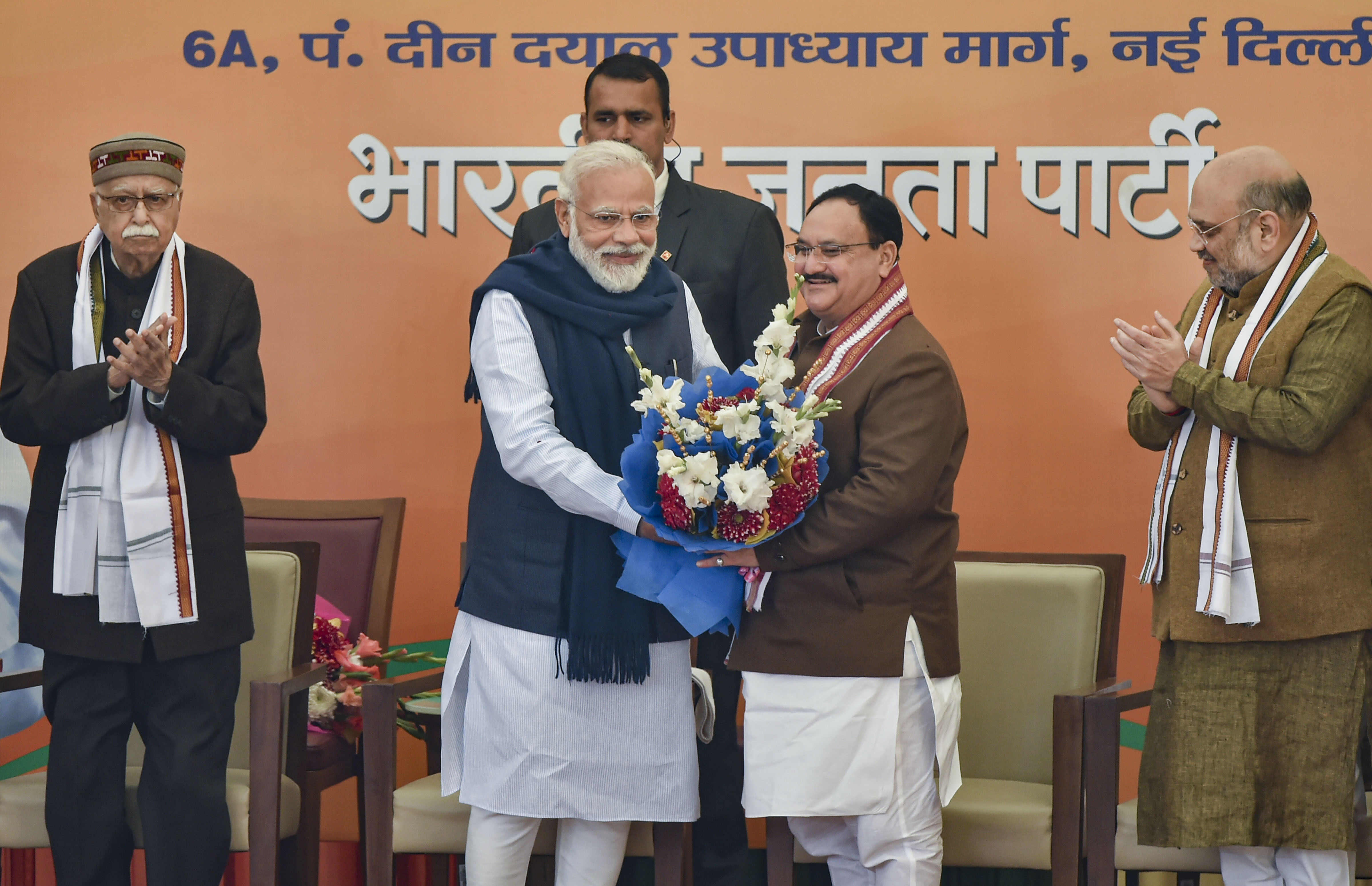 Prime Minister Narendra Modi with newly elected BJP National President JP Nadda (C), after the latter was elected as the new chief of the BJP unit unopposed, at BJP HQ in New Delhi, Monday, January 20, 2020. Veteran party leader L.K. Advani (L) and Union home minister Amit Shah (R) are also seen.