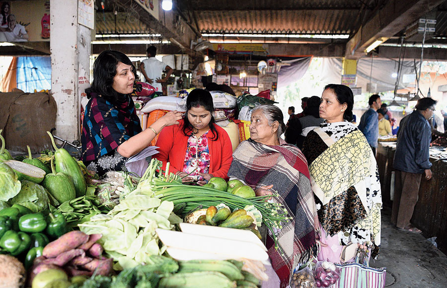 One of the campaigners against CAA-NPR-NRC speaks to shoppers at the market in Block D of Patuli on Sunday.