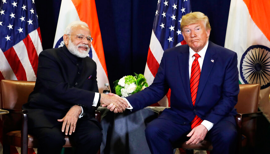 """Modi with Trump in New York on September 24 when the US President referred to the Prime Minister as """"the father of India""""."""