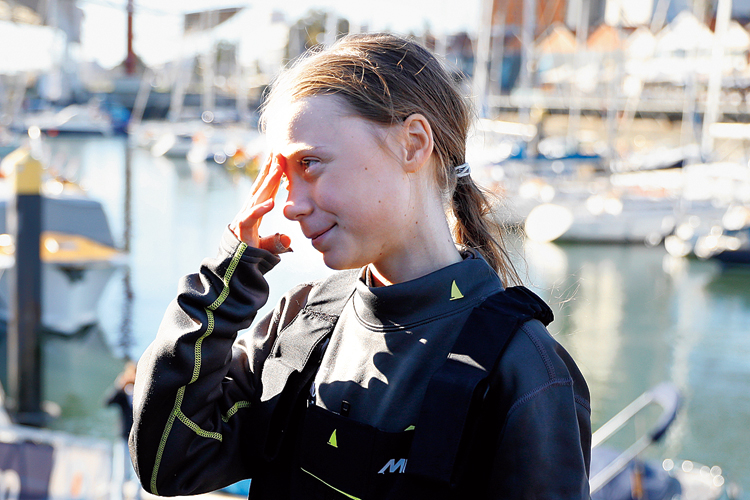 Swedish climate activist Greta Thunberg, who refused to take a plane because of emissions, after arriving in Lisbon on Tuesday aboard a sailboat