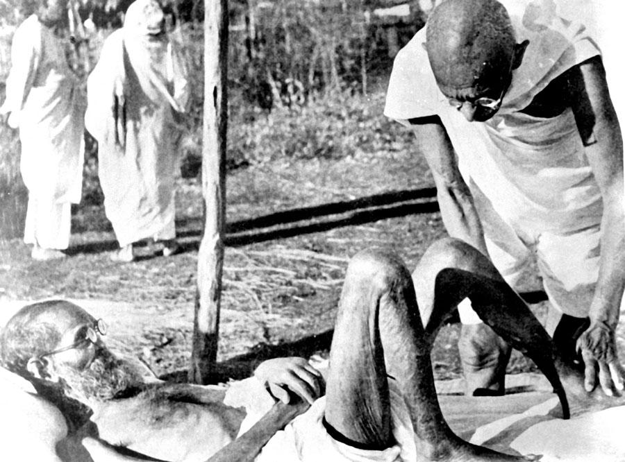 Gandhi attending a leprosy patient at Sevagram Ashram
