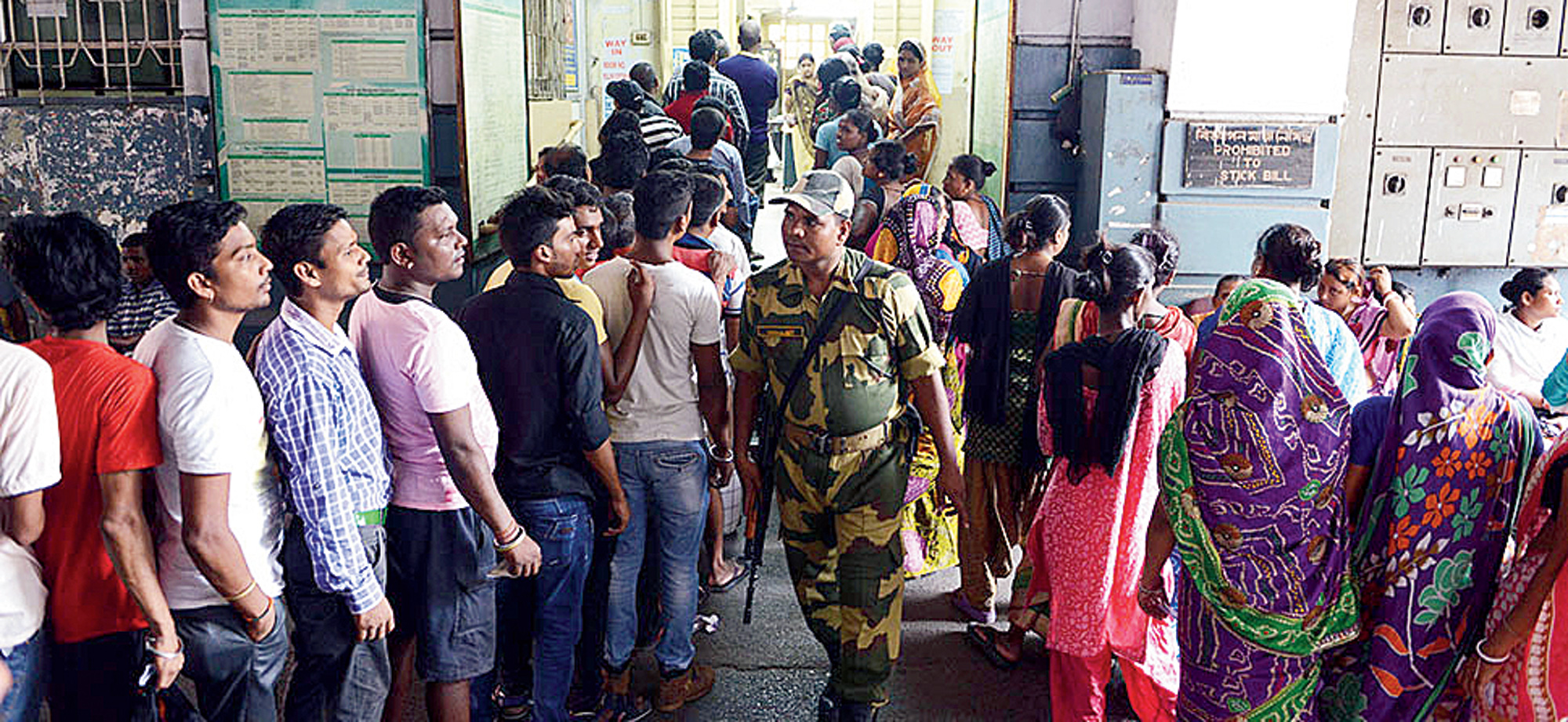 Queues outside a polling booth in West Bengal.