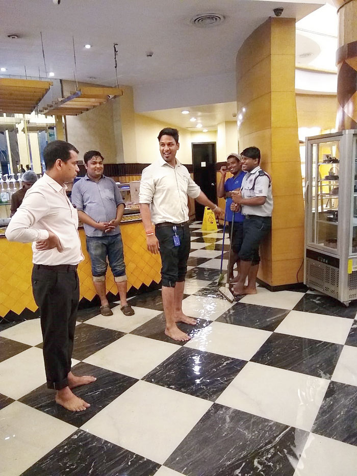 Flurys staff mop the floor after rainwater flooded the tea room on Park Street on Friday