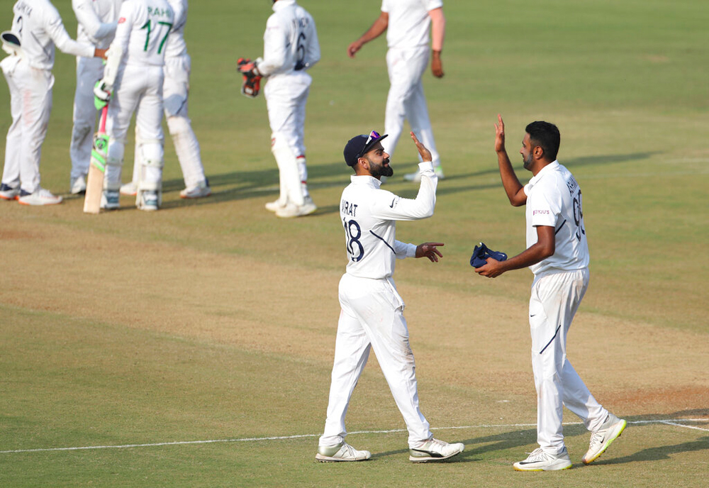 Virat Kohli celebrates with Ravichandran Ashwin after India's win on the third day of first Test against Bangladesh in Indore on Saturday
