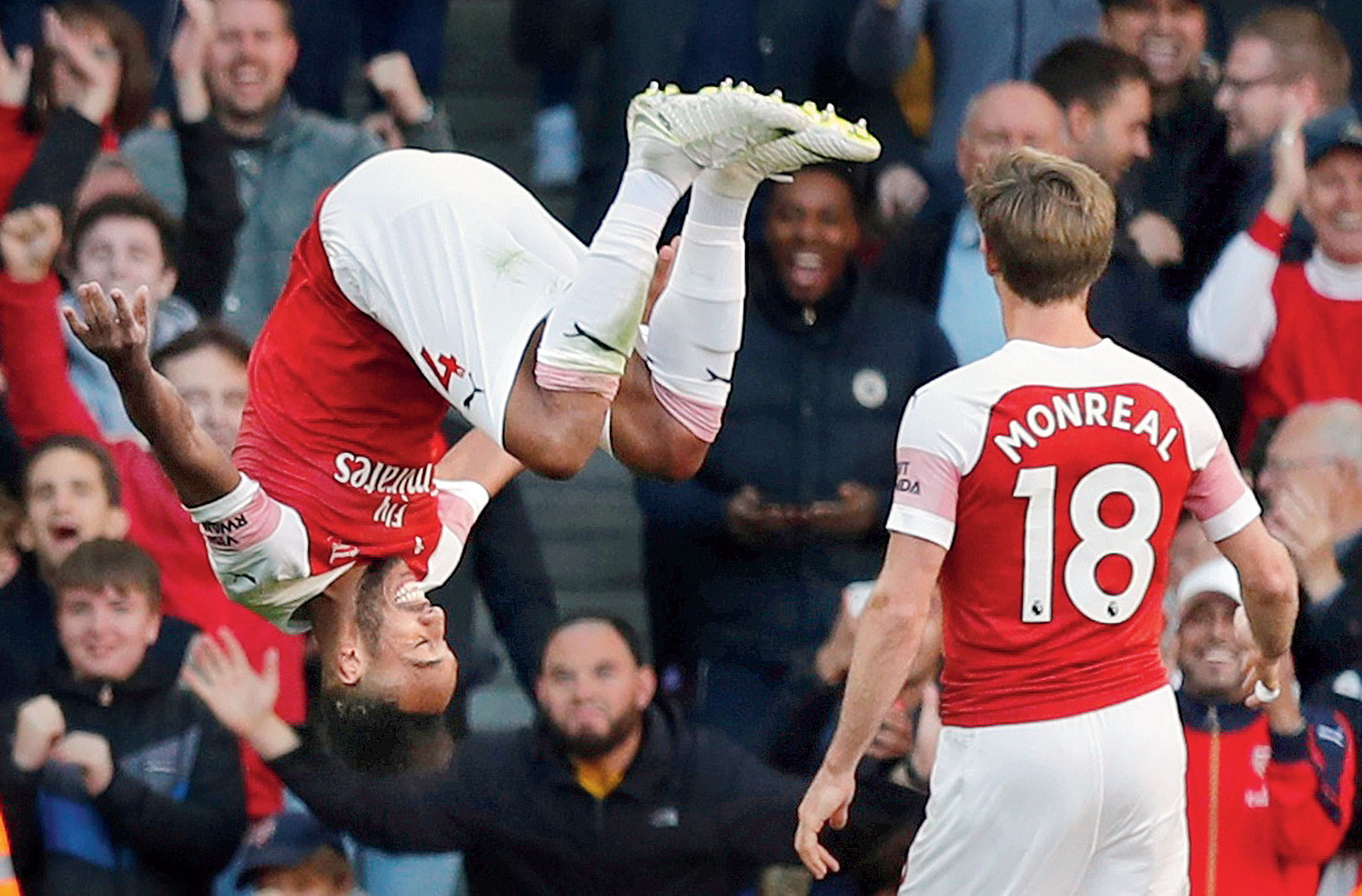 Arsenal's Pierre-Emerick Aubameyang (Left), who would be returning to action against Manchester City on Wednesday