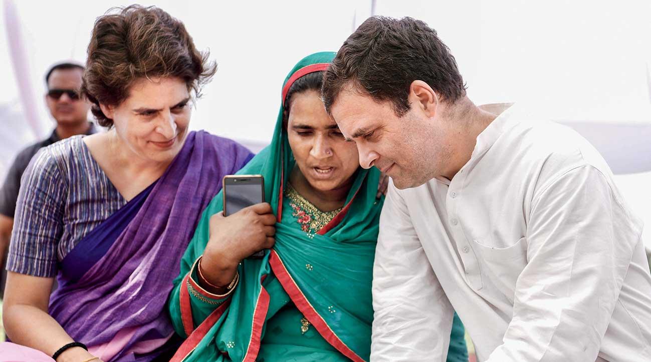 Priyanka Gandhi Vadra and Rahul Gandhi with a participant at a Mahila Workers' meeting in Amethi on Saturday.