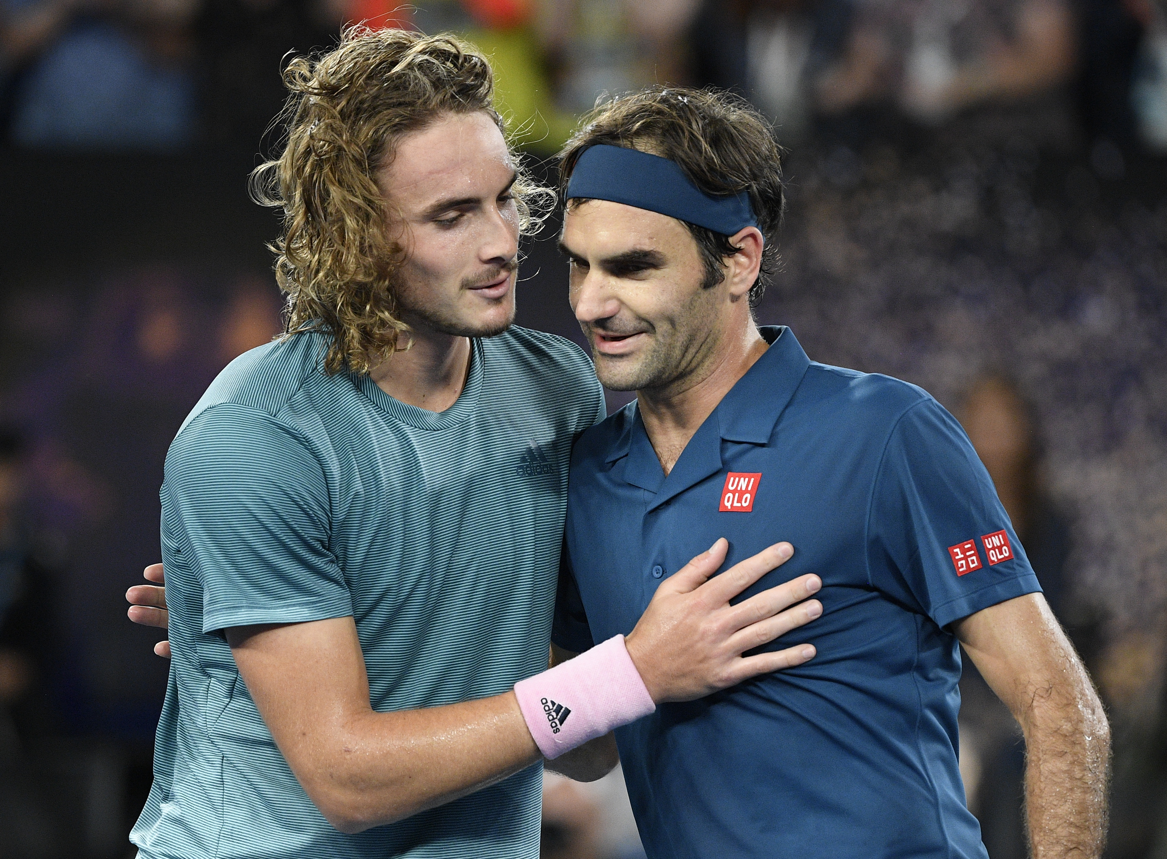 Greece's Stefanos Tsitsipas (left) is congratulated by Roger Federer after winning their fourth-round match at the Australian Open in Melbourne on Sunday.