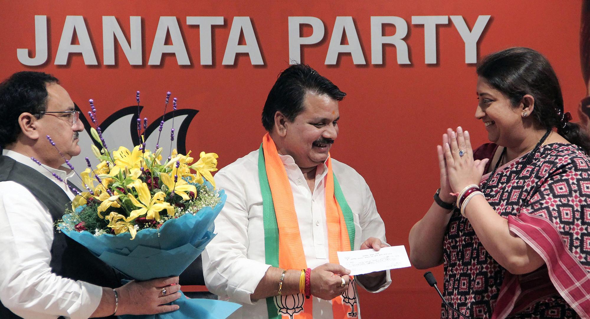 BSP leader Chandra Prakash Mishra joins Bharatiya Janata Party in the presence of senior party leaders Smriti Irani and Jagat Prakash Nadda at Party Headquaters, in New Delhi on Wednesday, March 20, 2019.