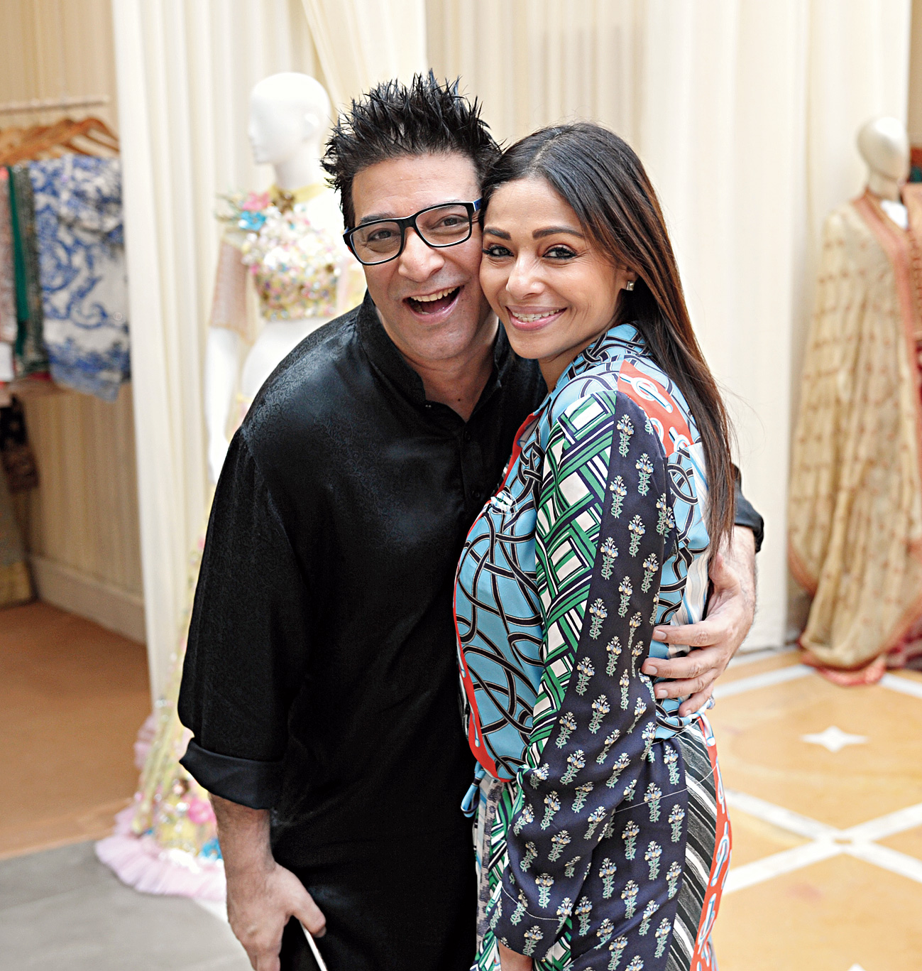 """Fashion designer Suneet Varma with friend Kalyani Chawla. """"I don't participate a lot in exhibitions, so it's nice to get a sense of what everybody else is doing. Actually, if it wasn't for Madhu, I wouldn't be doing it. There is something welcoming and warm about her,"""" said Suneet, who had a blast of a Calcutta visit, what with bekti on his platter """"non-stop""""."""