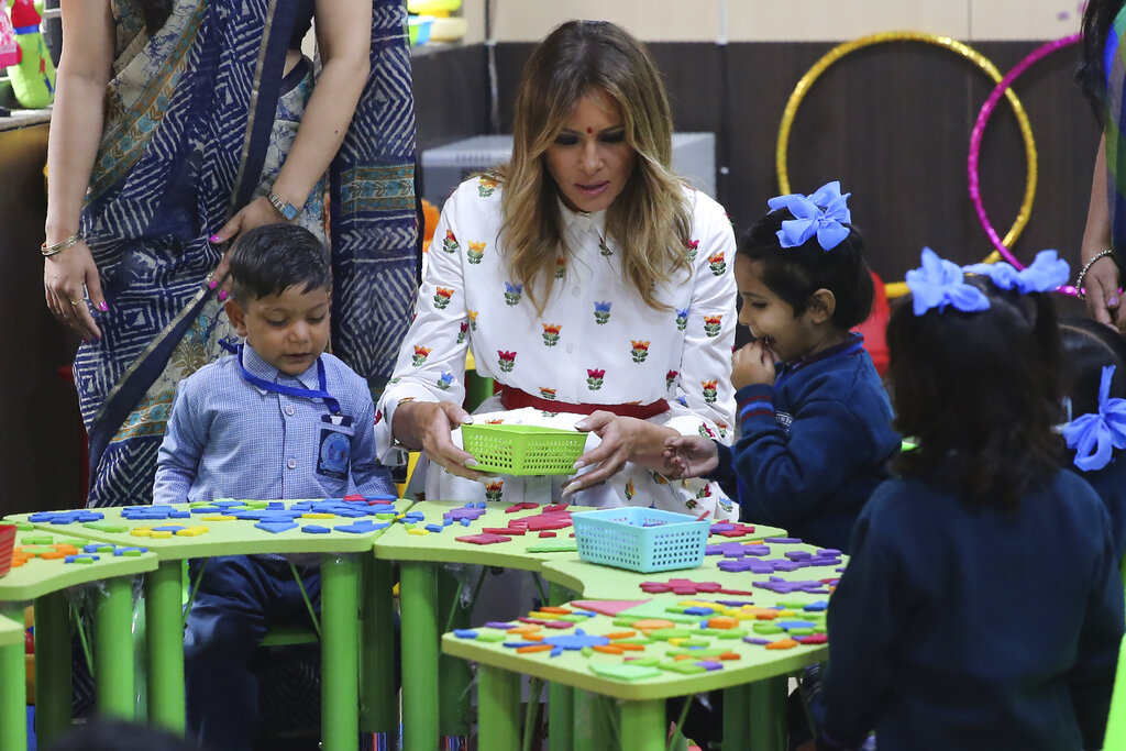 US First Lady Melania Trump participates in an activity with children in an activity room at Sarvodaya Co-Educational Senior Secondary School in New Delhi