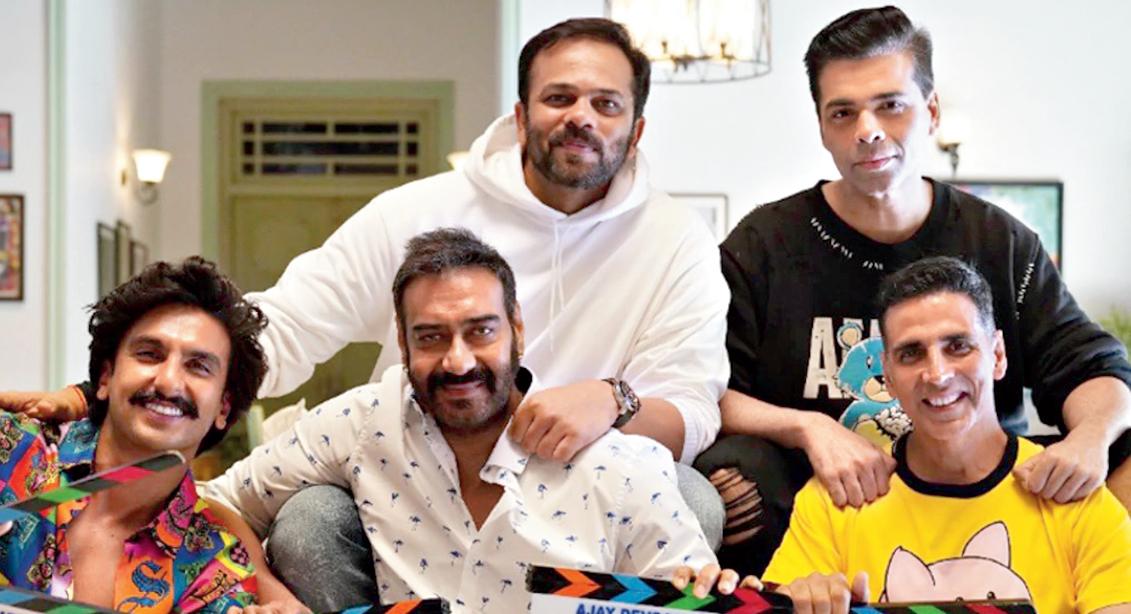 Rohit with Karan Johar and his 'cops' — Ranveer Singh who plays Simmba, Ajay Devgn as Singham and Akshay Kumar as Sooryavanshi