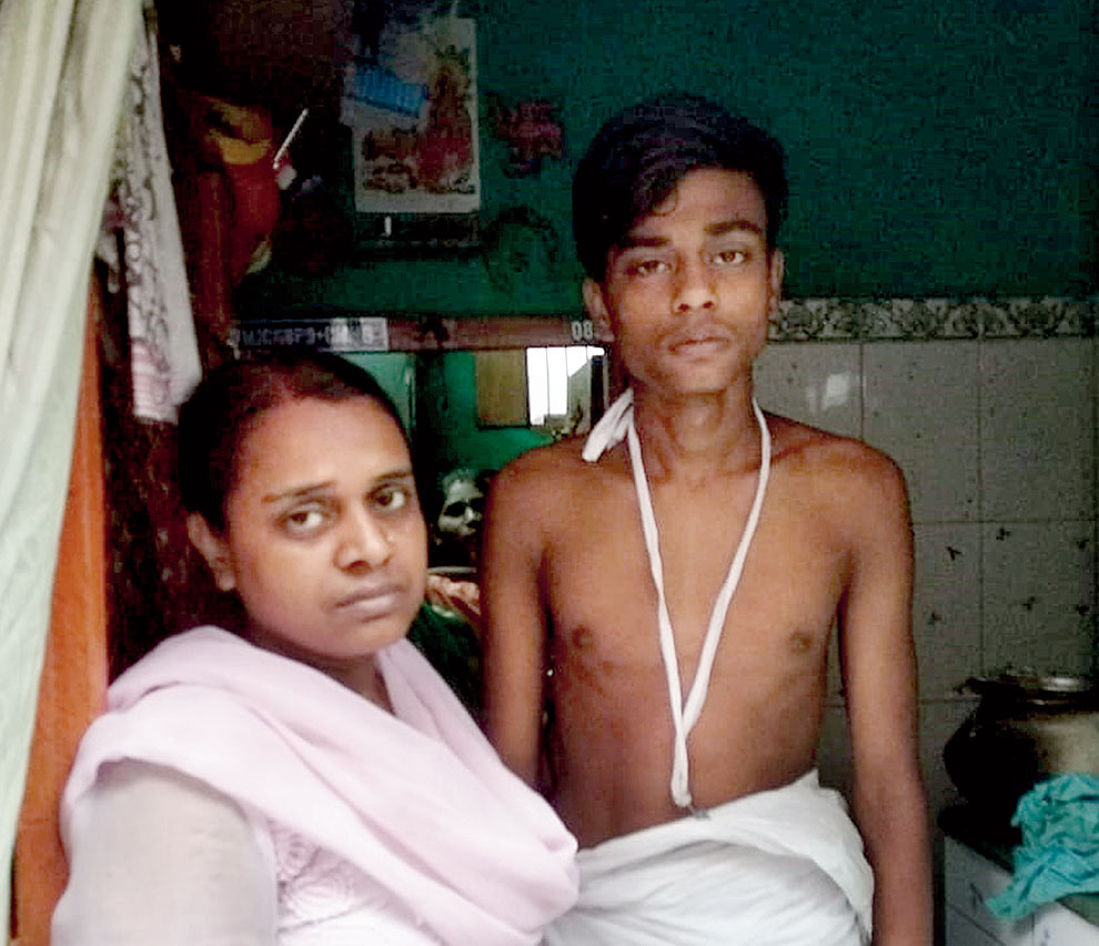 Akhya Nayak's wife Rita and son Rohan at their house in Kidderpore on Wednesday.