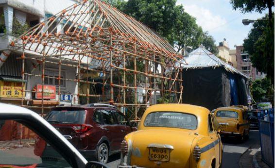 A Durga Puja pandal blocking a road in Kalighat.