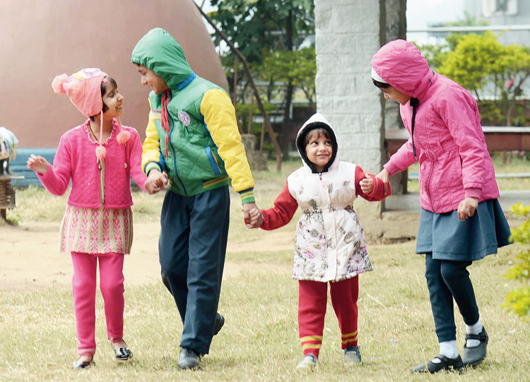 Winter gear: Children enjoy the chill at Kanke Dam park in Ranchi on Tuesday.