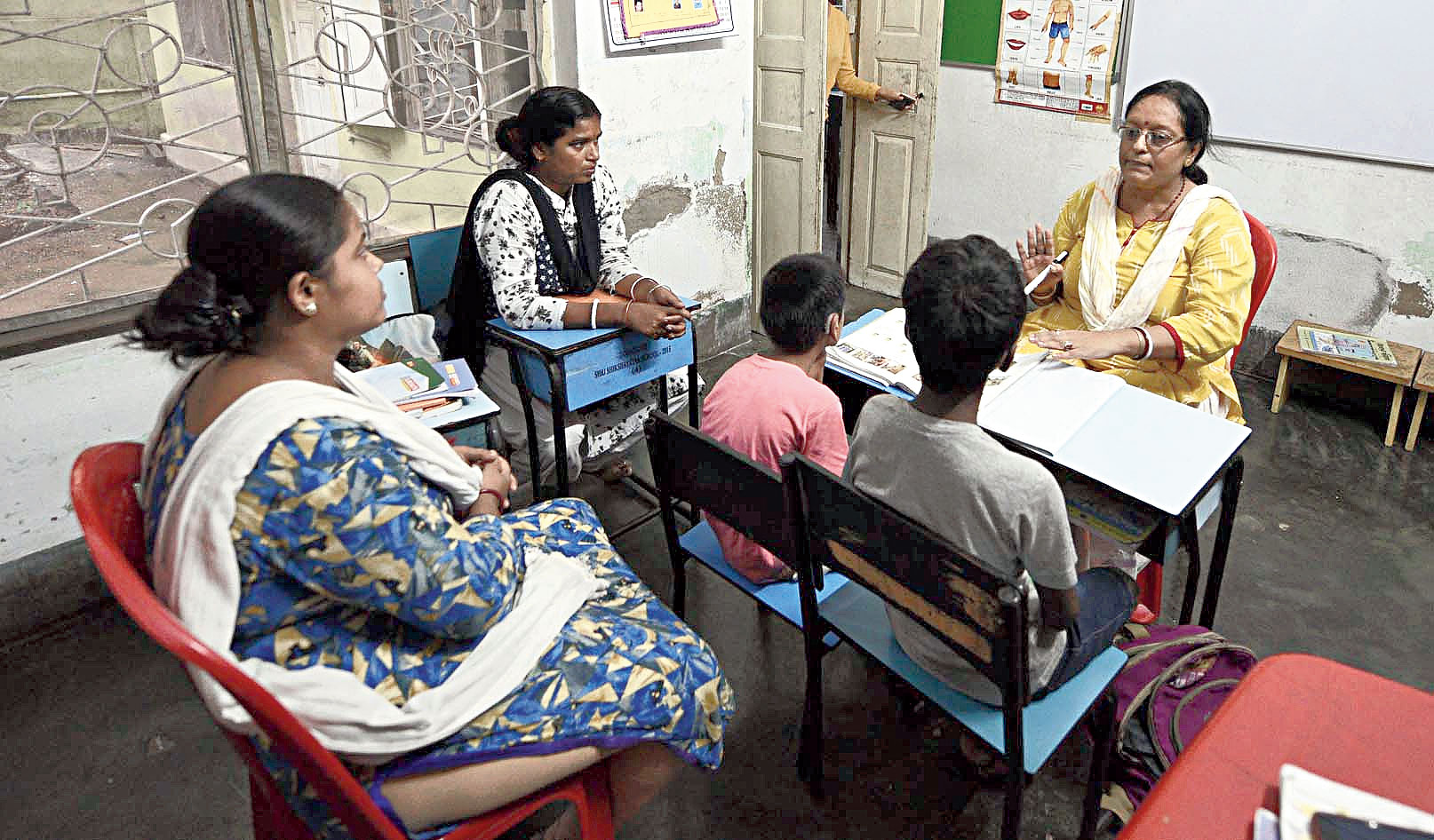 Parents attend a class along with their children at Anwesha's centre in Jadavpur.