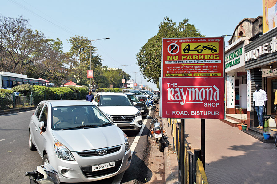 Cars parked at a no-parking zone on Bistupur Main Road in Jamshedpur.