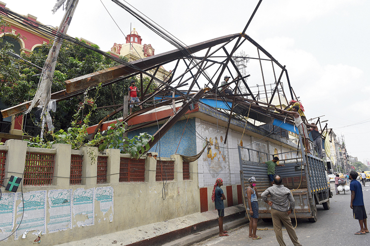 A hoarding over MG Road Metro station that was damaged during Wednesday's storm