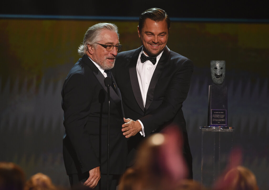 Leonardo DiCaprio, right, presents the lifetime achievement award to Robert De Niro at the 26th annual Screen Actors Guild Awards at the Shrine Auditorium & Expo Hall on Sunday, January 19, 2020, in Los Angeles