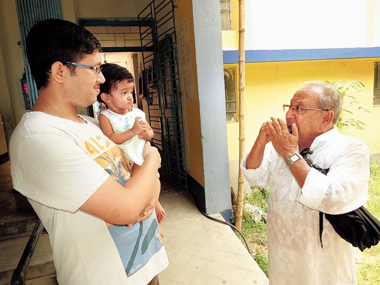 Debkumar Palit, 81, plays a mouth organ