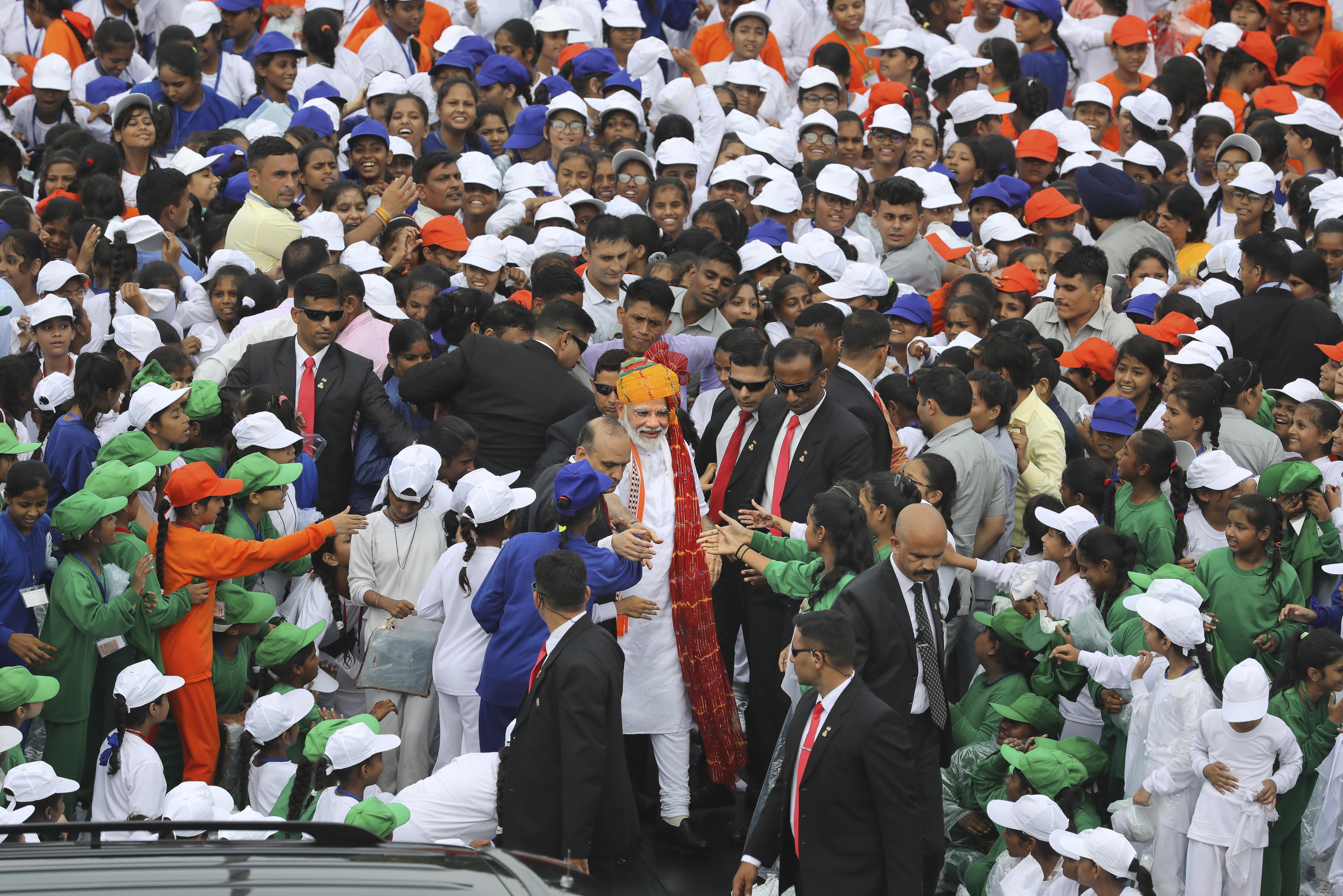 Prime Minister Narendra Modi greets school children in New Delhi on Independence Day