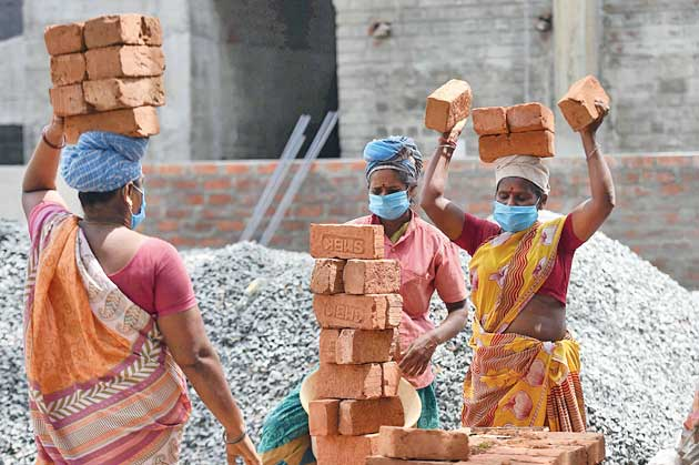Labourers in Chennai on Tuesday.