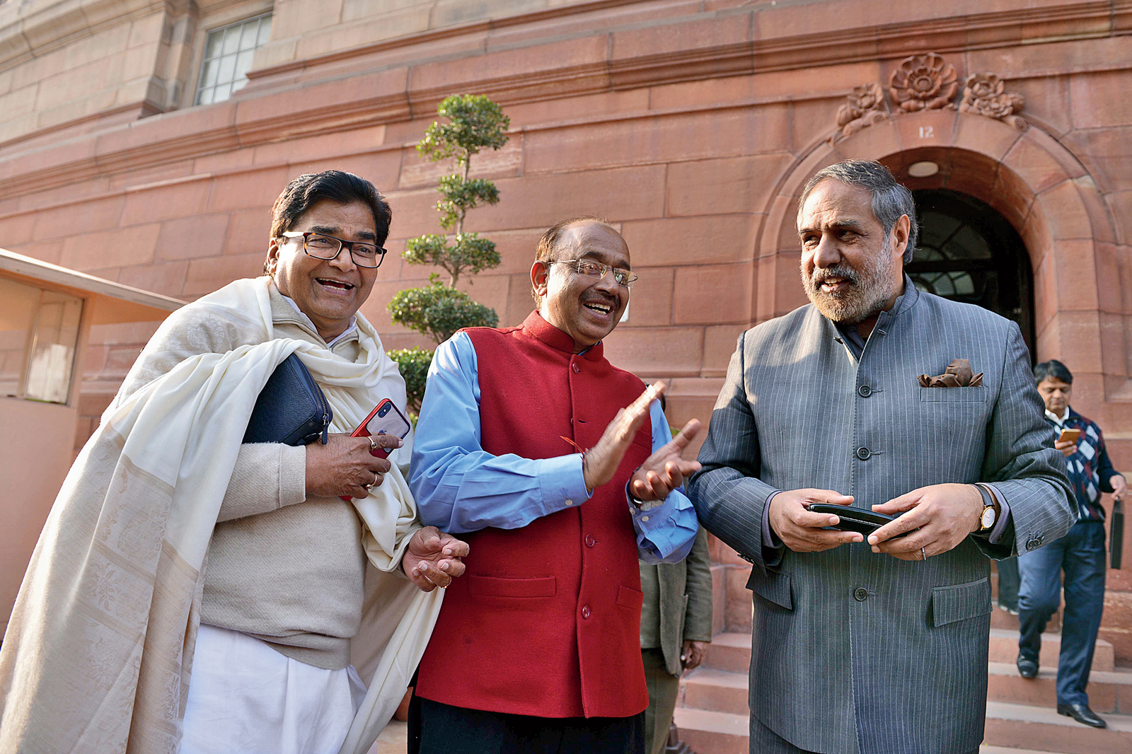 Ramgopal Yadav of the Samajwadi Party, Vijay Goel of the BJP and Anand Sharma of the Congress outside Parliament on Monday.