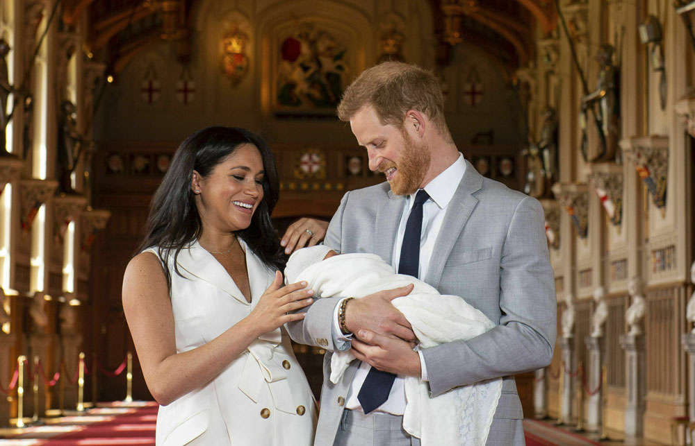 Prince Harry and Meghan, the Duchess of Sussex, pose with Master Archie at Windsor Castle on Wednesday.