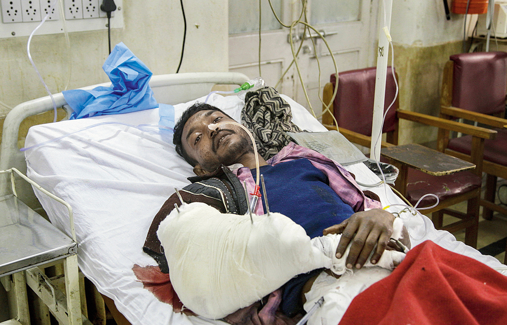 Jahiruddin Sarkar, who was injured in the attack, at a hospital in Srinagar
