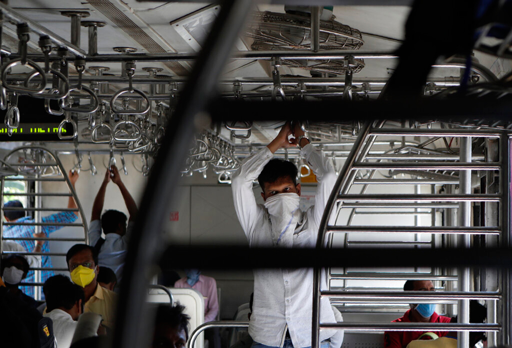Commuters in a local train in Mumbai on Wednesday. In India, there is also a belief that the approaching hot weather will kill off the coronavirus.