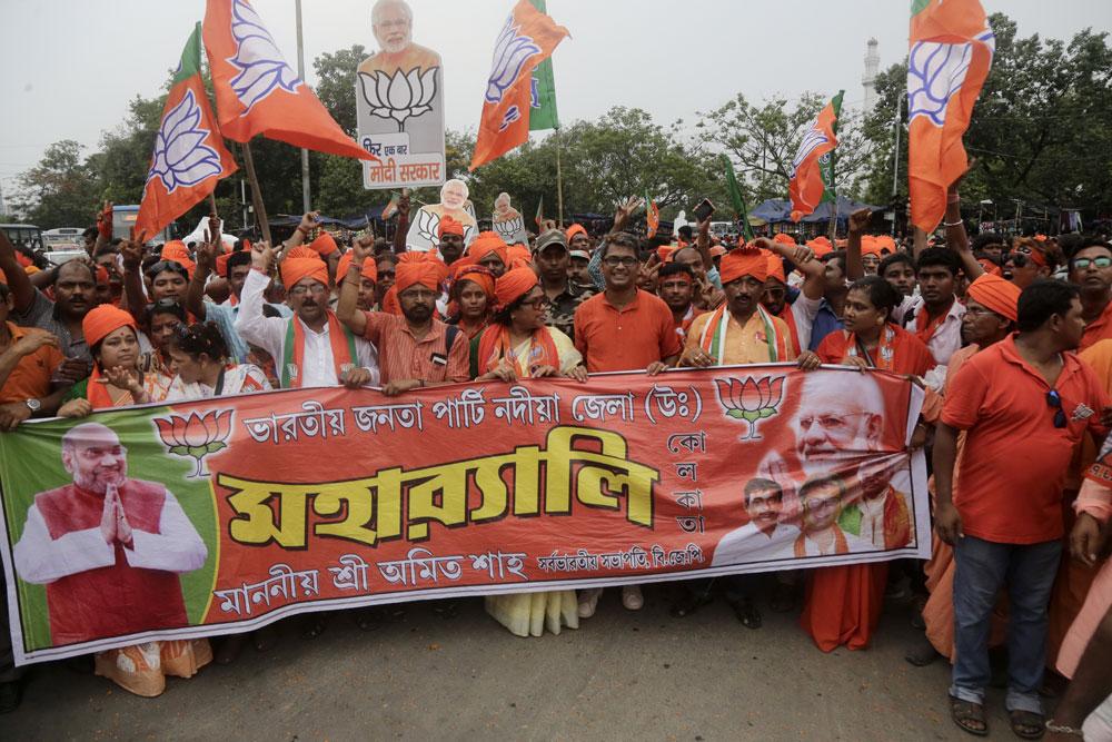 Bharatiya Janata Party workers shout slogans as they walk in an election rally in Kolkata, India, Tuesday, May 14, 2019.