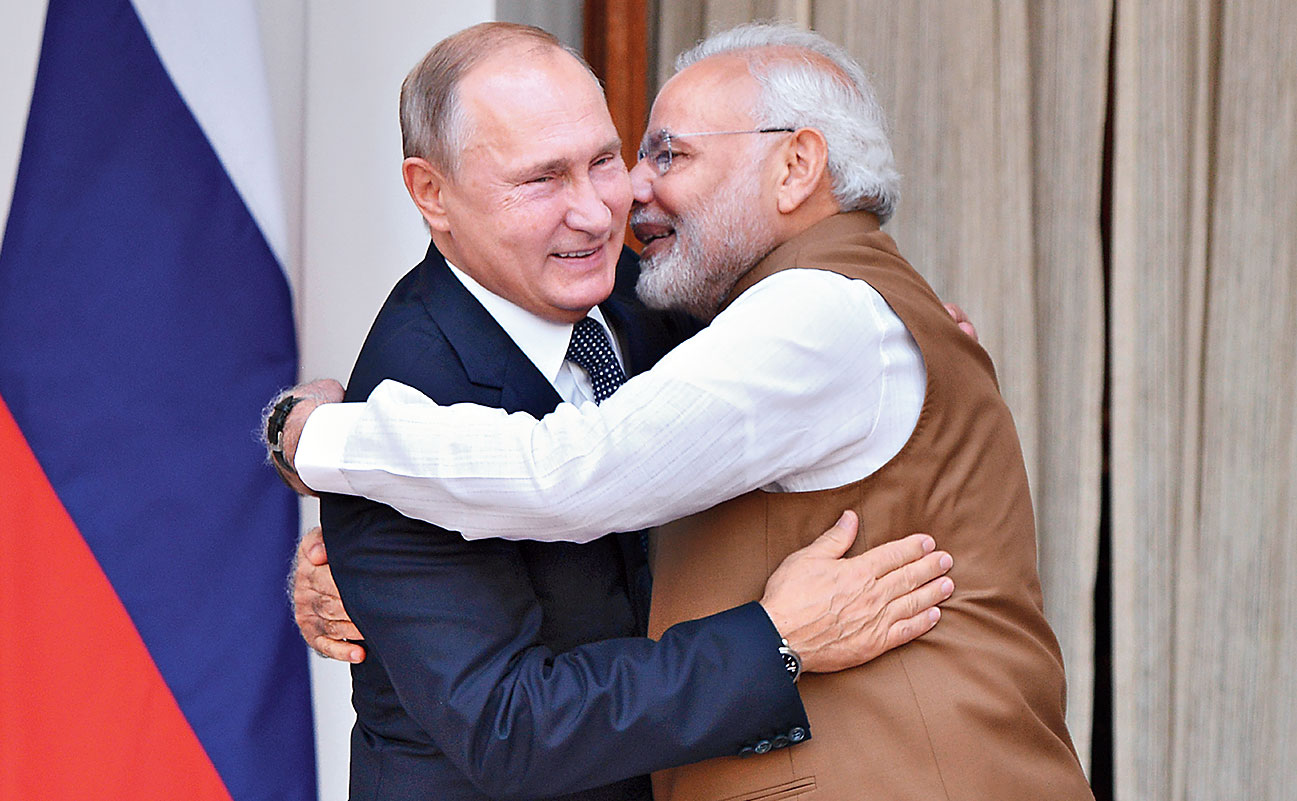 Modi hugs Putin in New Delhi.