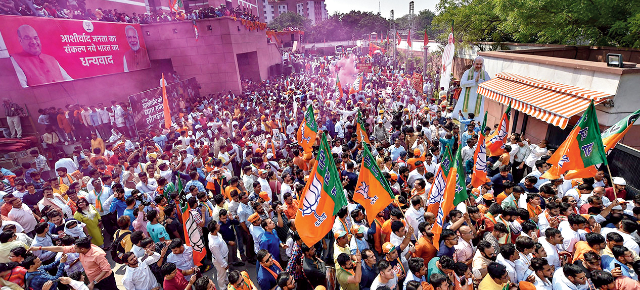 BJP supporters celebrate their victory in the 2019 Lok Sabha elections at the party headquarters in New Delhi, Thursday, May 23, 2019.