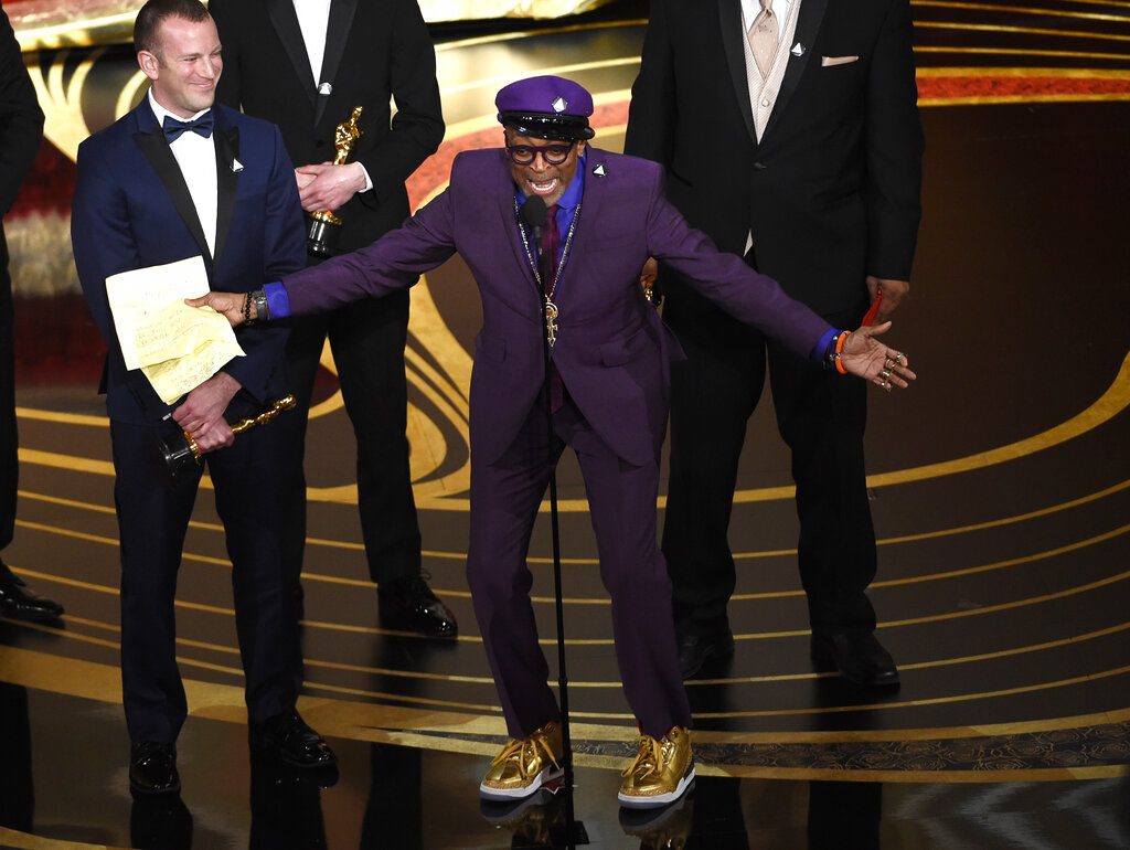 Charlie Wachtel, left, and Spike Lee accept the award for best adapted screenplay for BlacKkKlansman at the Oscars.