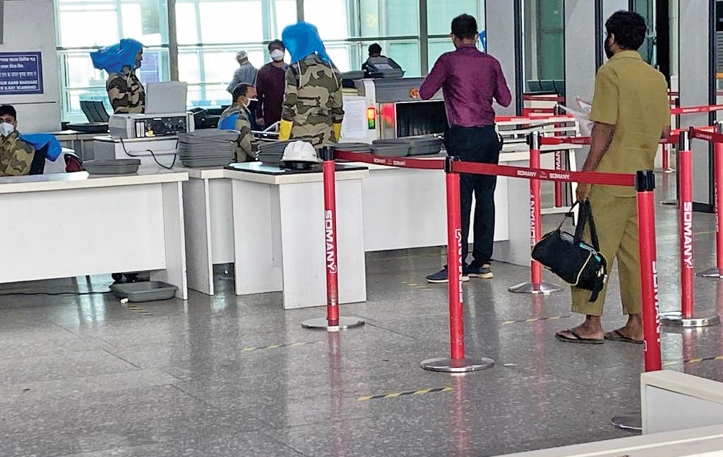 At the security-check counter, procedures are contact-less. CISF personnel will not handle trays or bags. Passenger will have to collect the bag and put the tray back at the original place. While frisking, CISF personnel will hold metal detectors with an extended handle to maintain a distance from the passenger. No pat-downs.